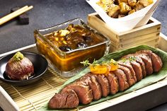 Grilled Wagyu fillet steak, roasted Jerusalem artichokes, mushroom demi-glace, a sushi ball with a slice of blow-torched Wagyu