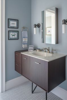 Jute® vanity     Ceramic/Impressions® sink    Artifacts® faucet spout  and  handles   Verdera® medicine cabinet     Traditional design gets a kick of mid-mod style with a sleek vanity and textural floor tile.