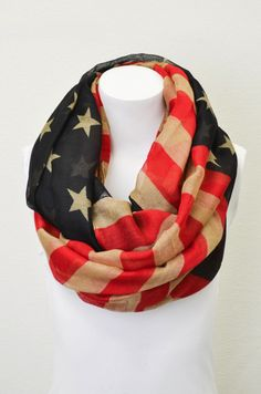 This will become your go to scarf! Fun patriotic print in a muted color tones - matches your outfit just right! Lightweight enough to wear this Spring! In store and online: http://8thstreetboutique.com/products/land-of-the-free-infinity-scarf