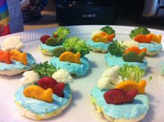 I made a healthy snack with a fun sea life theme! I called them Nemo Cakes. Mini rice cakes, cream cheese with a drop of blue food coloring, goldfish crackers and veggies!