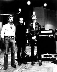 Robert Fripp, Brian Eno and David Bowie behind the scenes in the studio where they are recorded Heroes in 1977