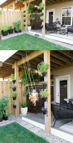backyard garden Modern design ideas for a small backyard // DIY rock landscaping around a gray Trex platform deck // Hanging herbs // DIY outdoor cat perches // DIY HVAC unit screen // small garden ideas // hanging ferns on a patio