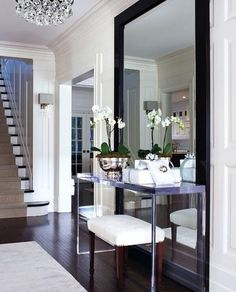 floor to ceiling mirror for the front hall way to make the flat look bigger