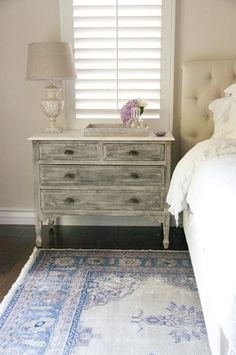 love the distressed chest with the faded blue antique Turkish rug; DL Rhein - bedrooms..