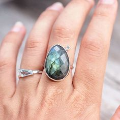 Finished this labradorite and moonstone ring the other day and couldn't resist sharing it! Can't help but move my fingers to enjoy those flashing gems. Already sold, but the ring on the left is a fancy cut aquamarine ring up for auction this weekend - ends in a few hours.