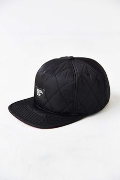 2ed4173abcf Perfect snapback hat from Stussy. Nylon and cotton construction topped with  quilted design. Complete with an adjustable snapback closure.