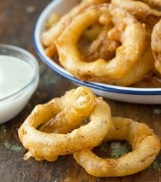 Beer Battered Onion Rings. They are incredibly easy to make, and they are definitely much less fussy than homemade fries. All you have to do is slice them, dunk them in a quick batter, and fry 'em up. You can serve them as an appetizer with a dip (ranch dressing always proves popular) or as a side with practically anything.