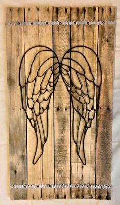 Metal Angel Wings on pallet wood, with brick tie trim