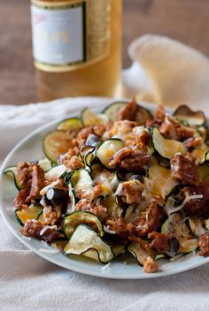 Zucchini Nachos Recipe - To make low carb use ground beef instead of Spicy Black Bean Veggie Burgers.