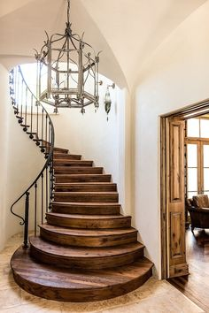 Perfect period design :: French Country winding wood staircase with iron railing...