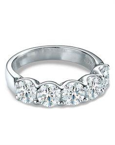 A shared-prong, U-shaped mounting Forevermark diamonds.