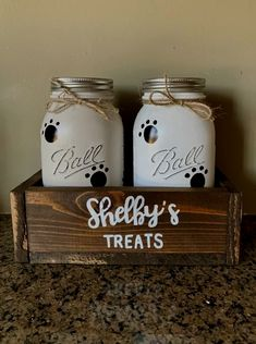 Super cute treat holder for pets! I can attach chalkboard labels, put your pups' names on the jars, or personalize the box. The jars can be done in any color combo as well! All jars are sprayed with polyurethane for protection from chipping and safe for handwashing. ***If you would like to customize your piece then please include the following in your notes when you purchase: Colors you'd like for your jars, stain on the box, and any other details you would like for me to include (chan..