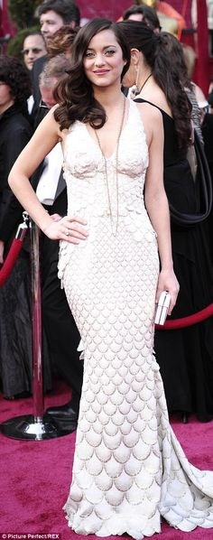Marion Cotillard was sinuous in a clinging white and gold fish scale gown by her countryman Jean Paul Gaultier in 2008