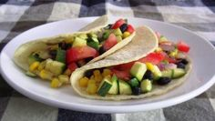 "The Easiest Veggie Tacos EVER : ""Overwhelmed by all that summer squash popping up in your garden? Try these super simple bean & veggie tacos for a different way to use your zucchini and other summer squash.    Hungry for more? Check out my Summer Squash Recipes board on Pinterest! http://pinterest.com/poorgrleatswell/summer-squash-recipes/ "" -Poor Girl Eats Well blogger share"