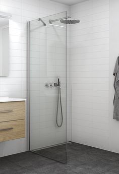 Classic and simple wetroom walk in shower enclosure with wall support.