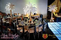 Planning a New Years party? These feather centerpieces and the black and gold theme will make your event look way more expensive than it is. Black and gold party with feather centerpiece is the way to go for your New Years event decoration. New Years Party, New Years Eve, Black And Gold Theme, Rent Party, New Year's Eve 2019, Feather Centerpieces, New Year New You, Gold Party, Event Venues