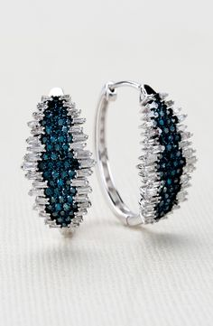 We feel fiercely fashionable in these diamond hoops. Never back down from a fashion like this! | 1.50ctw Round And Baguette Blue And White Diamond 10k White Gold Earrings