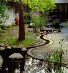 Japanese garden idea would work for areas that need a way of drainage that looks good.