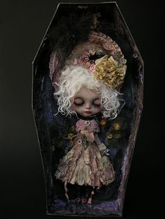 I need to deck out my doll's coffin! Lots of nice little fabrics, vintage hankies and such.