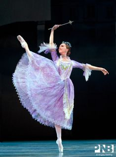 PNB soloist Kylee Kitchens dancing the role Fairy Godmother in a lavender tulle skirt designed by Martin Pakledinaz for Kent Stowell's Cinderella. Photo by Angela Sterling.