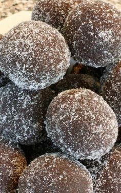 BRANDY OR RUM BALLS - 1 (5 ounce) can evaporated milk 1 cup semisweet chocolate chips 1/2 cup brandy 1 (16 ounce) pa...