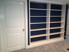 Custom built-in shelving in Shrewsbury, MA basement remodel