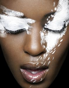 White against brown beautiful makeup style.