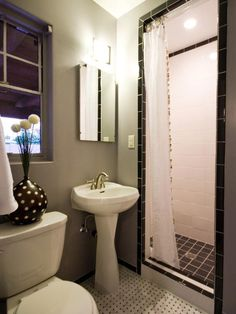 Small Bathrooms That Pack a Punch: Mix patterns in a similar color palette, such as the vase and tile featured here, to instantly give your small bath more character. From DIYnetwork.com