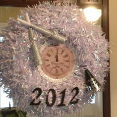 New Years wreath made with the printable clock pinned here on Pinterest!