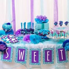 Put together a yummy candy land in dreamy purples and blues with a hint of DIY for a bridal shower or even wedding reception! Just blue-tiful!