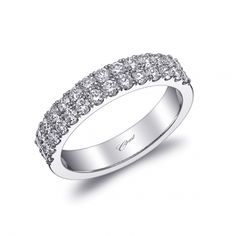 This wedding band from our Romance Collection is delicately set with two rows of round brilliant diamonds in microprongs. (WC20018)   #weddingband #bridetobe #bridalstyle