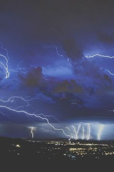Electrical storm storm blue sky city lights clouds lightning