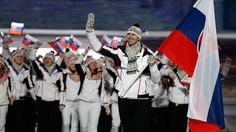 Slovakia's flag-bearer and Boston Bruins defenceman Zdeno Chara leads his country's contingent...