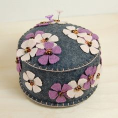 Grey Wool Felt Pincushion with Beaded Flowers in Hydrangea and Wheat Fields by TheBlueDaisy, via Flickr