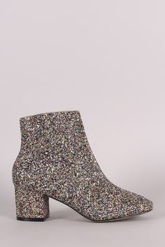 These chic booties feature a colorful glitter throughout, rounded square toe silhouette, and block heel. Finished with a cushioned insole, smooth lining, and side zip closure. Material: Glitter (man-m Block Heel Ankle Boots, Ankle Booties, Block Heels, Bootie Boots, Stiletto Heels, Shoes Heels, High Heels, Chanel, Sexy Boots