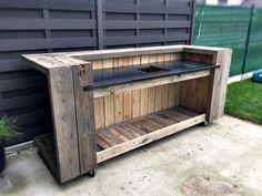 I made this pallet kitchen bar for my home. I took me three days to make it. I use it as an outdoor kitchen, otherwise, when I meet some friends, I can tur