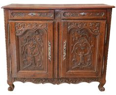 19th Century Buffet in oak with highly carved doors, circa 1860