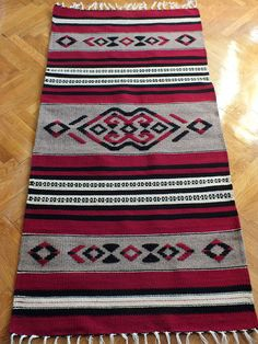 Handwoven wool rug made to order black red and grey