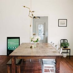 farm dining table w/ bench  -  A Bright and Airy Home in Central Texas | Design*Sponge