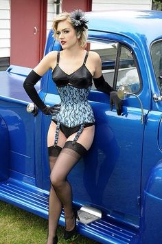 Great pin up shot. Vintage 1950s lingerie, corset, stockings.