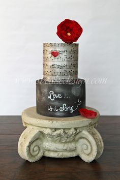 Love Song Cake - Love Song engagement cake - wafer paper top tier with fondant chalkboard finish on bottom tier.