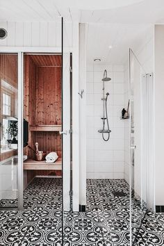 Open shower with printed tiles and wood accents