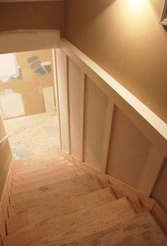 a Basement Staircase With Paint! Our depressing basement stairwell got a facelift with board and batten… :: HometalkSpiral Staircase Spiral Staircase may refer to: Concrete Basement Walls, Basement Stairway, Basement Steps, Old Basement, Basement Remodel Diy, Flooring For Stairs, Basement House, Basement Makeover, Basement Renovations
