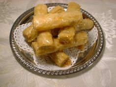 Sweet Phyllo Fingers, a delicious #Syrian sweet! New to Phyllo? No problem making these. Sweetened ground walnuts or pistachios are wrapped in phyllo sheets, baked and drizzled with simple syrup flavored with orange blossom. www.sittoskitchen.com
