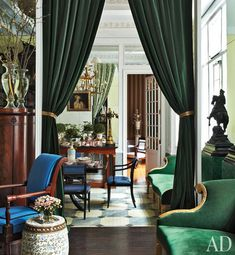 designer Jean-Paul Beaujard.  His New York City home: Love the elegant velvet portieres.