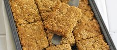Try our flapjack recipe, a really easy tray bake. Oaty flapjacks can be served up with a cup of tea or packed into lunch boxes for an energy hit Tray Bake Recipes, Sheet Cake Recipes, Gourmet Recipes, Baking Recipes, Sweet Recipes, Sheet Cakes, Yummy Recipes, Easy Flapjacks, Golden Syrup Flapjacks
