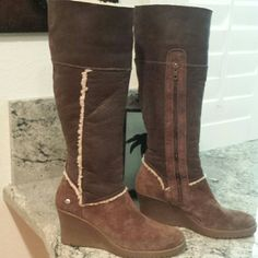 "UGG Tall leather suede boots, Sz 10 Pre-owned in Excellent condition! Shows no wear Drk brown with genuine sheepskin Wear up or folded  Side zipper Rubber 3 1/4"" wedge heel Soft, Warm and comfortable! **Price is firm!** UGG Shoes Wedges"