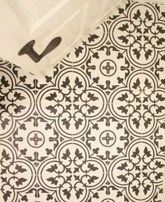 Merola Arte White Porcelain tile from Home Depot mimics encaustic cement tile, but at a much more affordable cost.