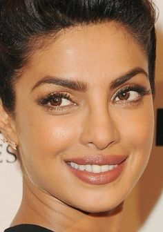 "Priyanka Chopra in a simple neutral lip color. Find the best ""nude"" lipstick shade for your skin tone."
