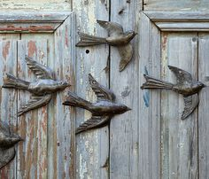 "Love these on an old weathered door or fence! ""Beyond Borders, a fantastic fair-trade organization, employs Haitian artists who hand-craft these charming wall birds from recycled 55-gallon oil drums using only a hammer and chisel"""
